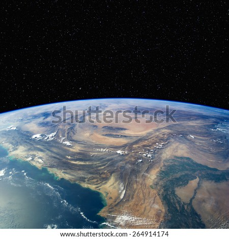 Pakistan from space with stars above. Elements of this image furnished by NASA.  - stock photo
