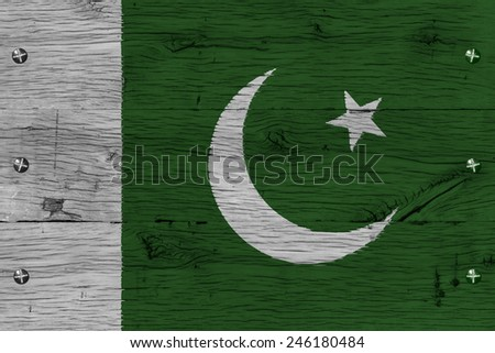 Pakistan national flag. Painting is colorful on wood of old train carriage. Fastened by screws or bolts. - stock photo