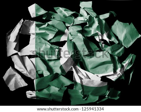 Pakistan. Pakistani flag painted on pieces of torn paper on black background - stock photo