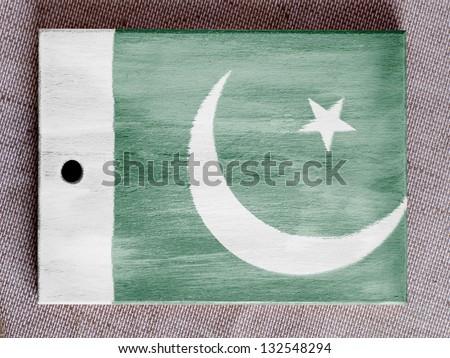 Pakistan. Pakistani flag painted over wooden board - stock photo