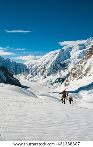 Pakistan, South Gasherbrum Glacier, July 2015 - Two climbers on the glacier, heading to Gasherbrum's Camp I, Baltoro Kangri Peak in the background