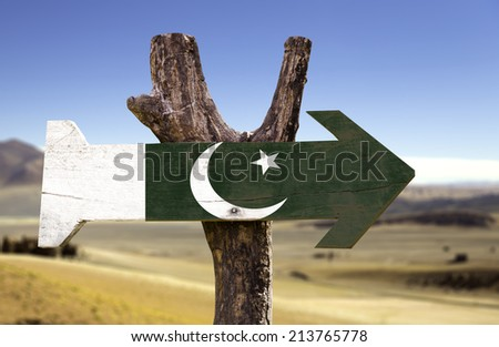 Pakistan wooden sign with a desert background - stock photo
