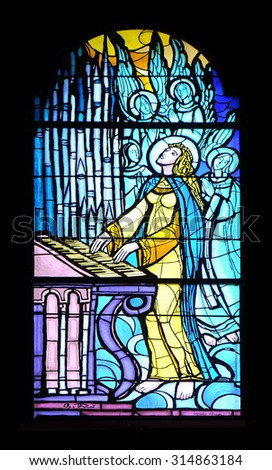 PAKRAC, CROATIA - MAY 07: Saint Cecilia, stained glass window in the Church of the Assumption of the Blessed Virgin Mary in Pakrac, Croatia on May 07, 2015 - stock photo