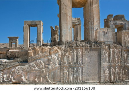 Palace in ruins with ancient bas-relief of Zoroastrians and figures of people and animals in Persepolis, Iran. Persepolis was a capital of the Achaemenid Empire (550 - 330 BC)  - stock photo