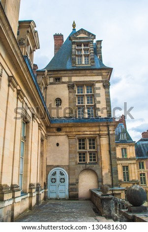 Palace of Fontainebleau, one of the largest French royal castles - stock photo