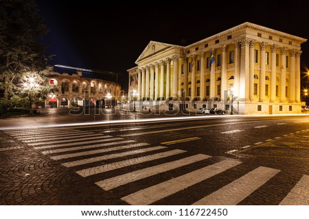 Palace of Gran Guardia and Roman Amphitheater on Piazza Bra in Verona at Night, Veneto, Italy - stock photo