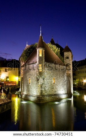 Palace of Isle  by night at Annecy in France - stock photo