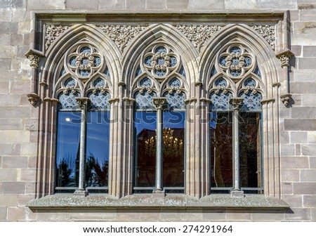 Palace of Sobrellano and church from Comillas, Santander, Spain. Detail of stained glass - stock photo