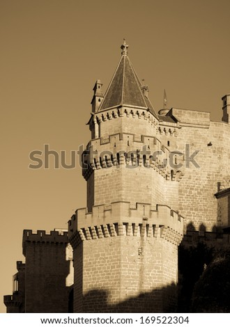 Palace of the Kings of Navarre at Olite in evening.  Spain. Imitation of old image - stock photo