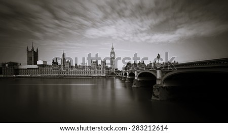 Palace of Westminster and Big Ben seen from South Bank, long exposure shot  - stock photo