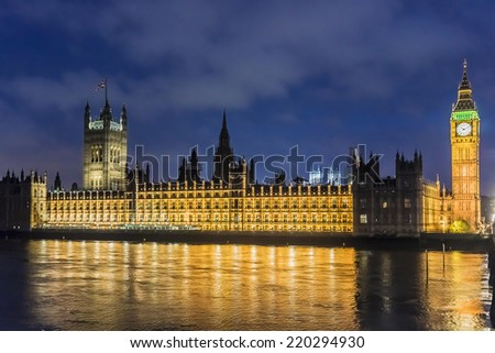 Palace of Westminster at night. Westminster (known as Houses of Parliament) located on Middlesex bank of River Thames in City of Westminster, London. - stock photo