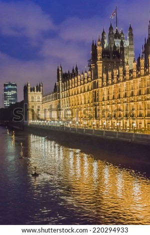 Palace of Westminster at night. Westminster (known as Houses of Parliament) located on Middlesex bank of River Thames in City of Westminster, London.