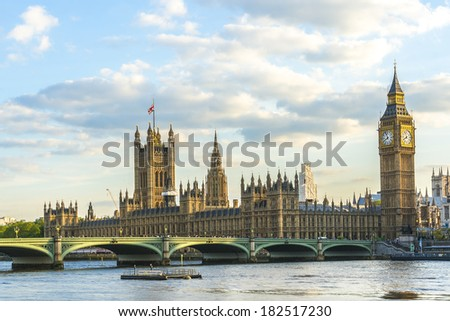 Palace of Westminster at sunset. Westminster (known as Houses of Parliament) located on Middlesex bank of River Thames in City of Westminster, London. - stock photo