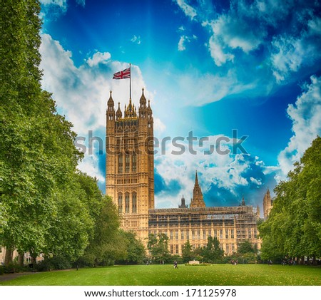 Palace of Westminster (Houses of Parliament) with Victoria Tower and Gardens. UNESCO World Heritage Site - stock photo