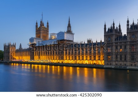 Palace of Westminster in London at night, UK - stock photo