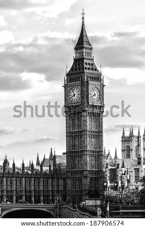 Palace of Westminster. Westminster (known as Houses of Parliament) located on Middlesex bank of River Thames in City of Westminster, London. Black and white, HDR. - stock photo