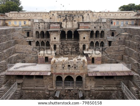 Palace section of the Abaneri stepwell in India's Rajasthan. Medieval construction is a turned up pyramid in the middle of nowhere.
