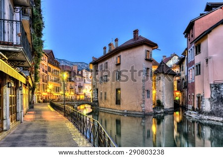 Palais de l'Ile jail and canal in Annecy old city by night, France, HDR - stock photo