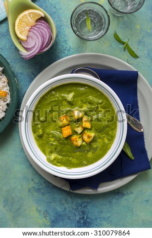 Palak Paneer , Indian food Spinach and Indian cottage cheese curry - Side dish for Rice and Flatbread , Top Down View - stock photo