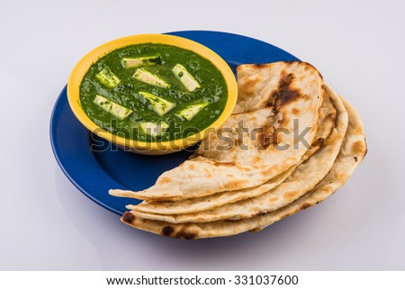 Palak Paneer , Indian food Spinach and Indian cottage cheese curry - Side dish for Rice and roti / chapati / indian bread / phulka / paratha   - stock photo