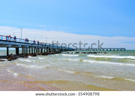 PALANGA, LITHUANIA - JULY 12, 2015: Unidentified people walk along on pier in the popular resort town of Palanga, Lithuania