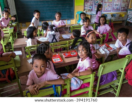 PALAWAN, PHILIPPINES - AUG 22: School children attending class at Paaralang Elementary School on the Island of Palawan in the Philippines on Aug 22, 2014.