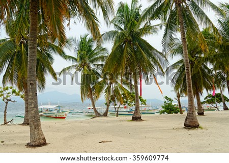 Palawan, Philippines - AUGUST 1, 2014: Cowrie Island in Honda Bay - a popular tourist destination