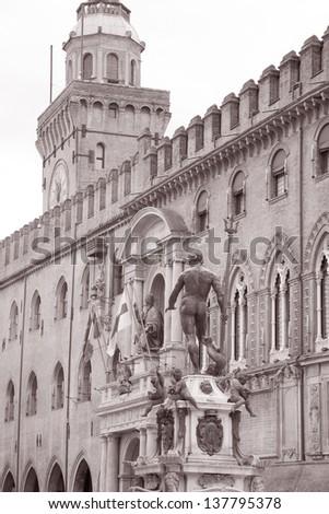Palazzo Comunale Palace and Neptune, Fountain - Fontana del Nettuno, Bologna, Italy in Black and White Sepia Tone - stock photo