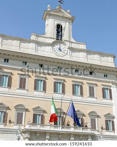 Palazzo Montecitorio headquarters of the Italian Parliament with the Italian flag - stock photo