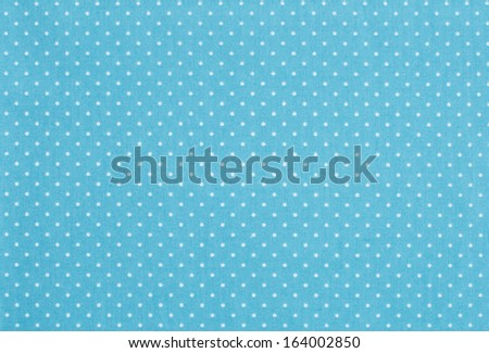 Pale blue fabric with white polka dot pattern - stock photo