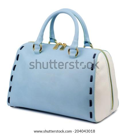 Pale blue female leather bag isolated on white background. - stock photo
