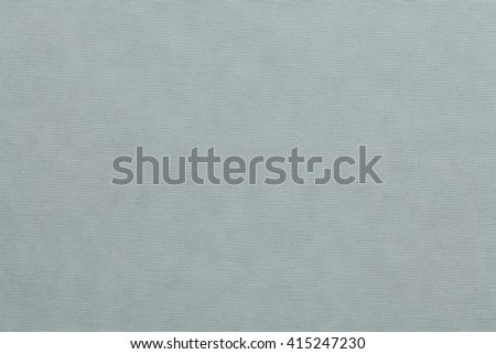 Pale blue stamped cardboard texture. Pale blue background. - stock photo