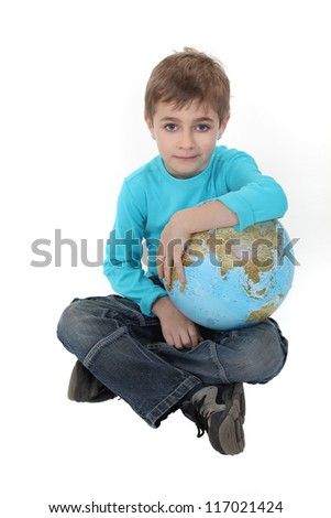 Pale boy with a globe in his lap - stock photo