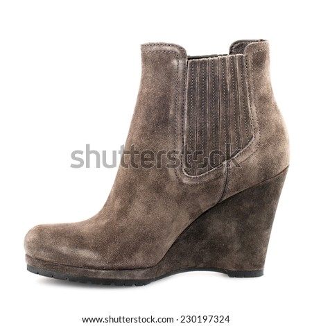 Pale brown suede boot isolated on white background.
