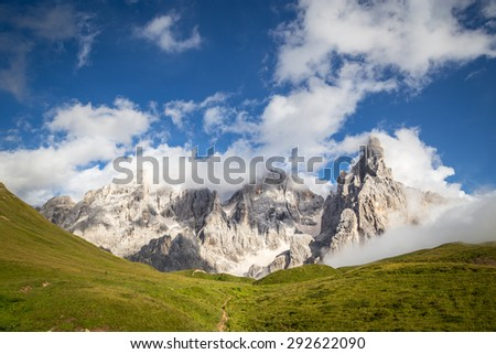 Pale di San Martino, Trentino Alto Adige, Italy. Pale di San Martino during a cloudy and windy day, with blue sky. - stock photo