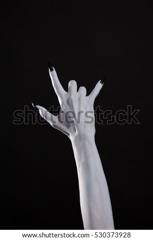Pale monster hand showing heavy metal symbol, Halloween theme
