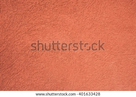 Pale orange plastered wall surface texture close up details as background image - stock photo