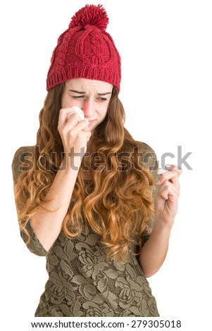 Pale sick woman with a flu checking if she has a fever with a thermometer in a clean background - stock photo