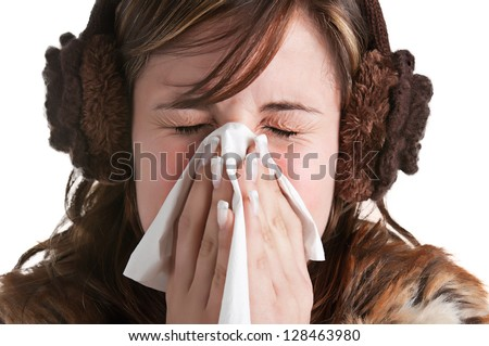Pale sick woman with a flu, sneezing, in a white background - stock photo