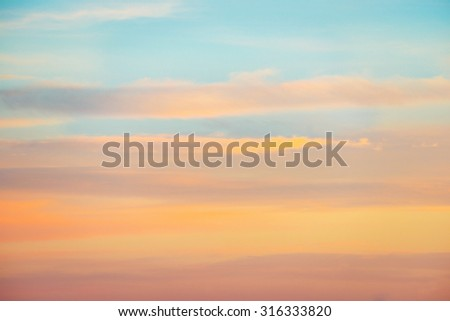 Pale sunset sky with pink, orange and red colors. Natural background - stock photo