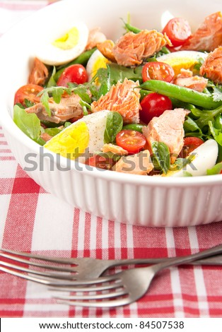 Paleo Diet Style Green Bean Salad with Boiled Eggs, Salmon, Tomatoes and Arugula - stock photo