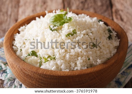 Paleo Food: Cauliflower rice with herbs close-up in the bowl. horizontal - stock photo
