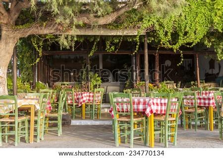 PALEOCHORA, CRETE, GREECE - SEPTEMBER 20. Greek Pizzeria at the beach promenade in Paleochora early morning on September 20. 2014.  - stock photo