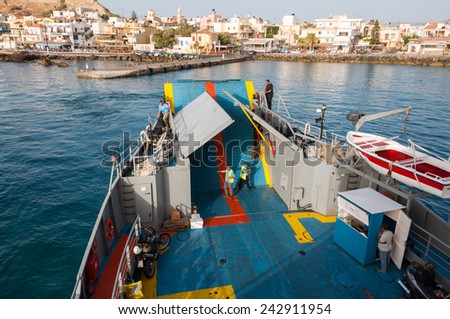 PALEOCHORA, CRETE, GREECE - SEPTEMBER 22, The ferry to Agia Roumeli and to Gavdos leaves the pier of Paleochora on September 22, 2014. The ferry connected the villages on the south coast of Crete. - stock photo