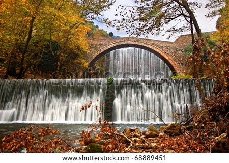 Paleokarya, old, stone, arched bridge, between two waterfalls. Trikala prefecture, Thessaly, Greece - stock photo