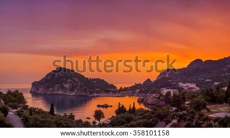 Paleokastritsa at sunset in COrfu Greece - stock photo