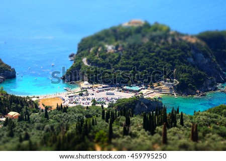 Paleokastritsa beach and bay view from above. Important tourist attraction in Corfu island. Tilt-shit effect applied. - stock photo