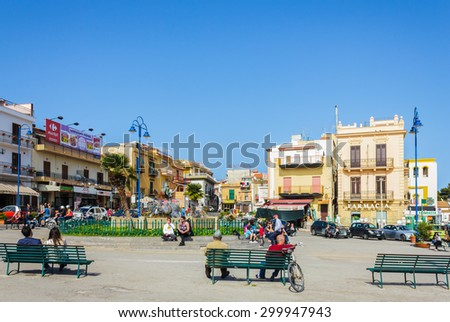 PALERMO, SICILY, ITALY- APRIL 1: People hanging out at square of Mondello, Palermo on April 1, 2015. Mondello is a small borough of Palermo, its beach lies between Mount Gallo and Mount Pellegrino.