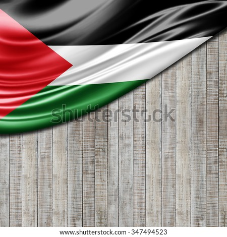 Palestine flag of silk with copyspace for your text or images and wood background
