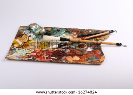 Palette and brushes of the artist - stock photo